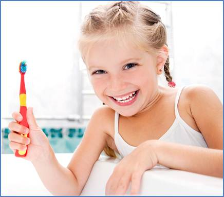 Girl with toothbrush